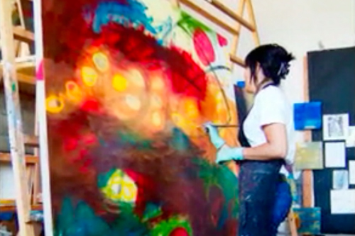 Pauletta painting at her studio.